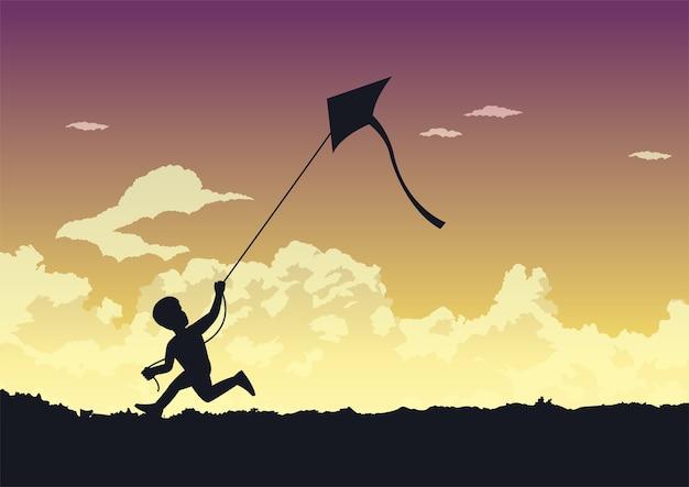 Garçon court pour jouer son cerf-volant joyeusement
