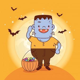 Garçon déguisé de frankenstein pour joyeuse fête d'halloween avec des bonbons et des chauves-souris volant vector illustration design