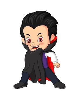 Garçon de dessin animé portant le costume de dracula d'halloween
