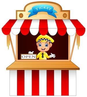 Garçon de dessin animé vendant un billet sur le stand