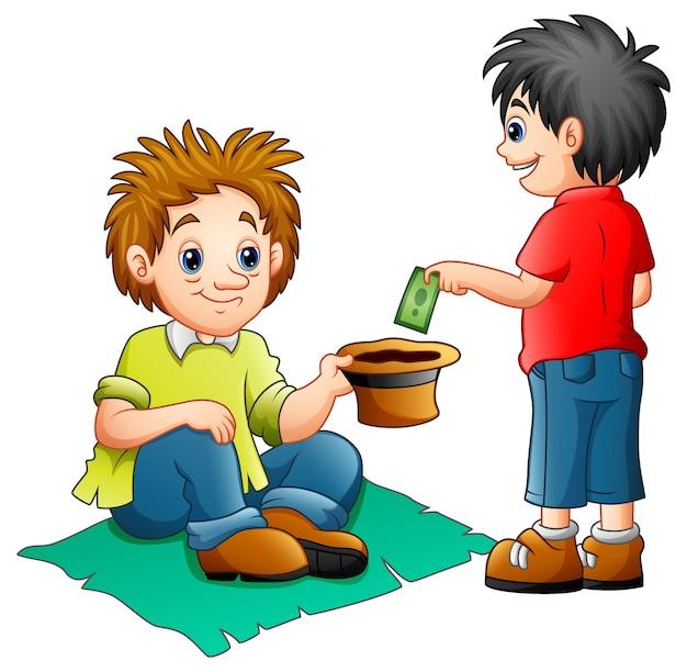 Un garçon donne de l'argent à un mendiant