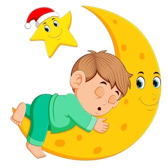 Un garçon dort sur la lune