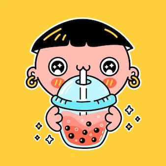 Un garçon drôle mignon boit du thé à bulles dans une tasse. vector hand drawn cartoon kawaii character illustration autocollant logo icône. concept d'affiche de personnage de dessin animé boba asiatique, garçon et thé à bulles