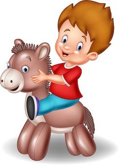 Garçon enfant dessin animé chevauchant un âne jouet