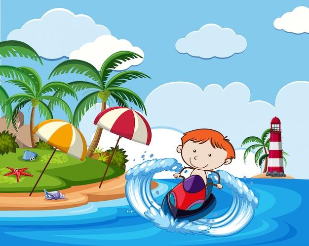 Un garçon équitation jetski en vacances