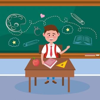 Garçon étudiant au bureau avec livre et pomme