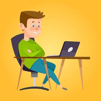 Garçon étudiant dans une salle de classe avec ordinateur portable.