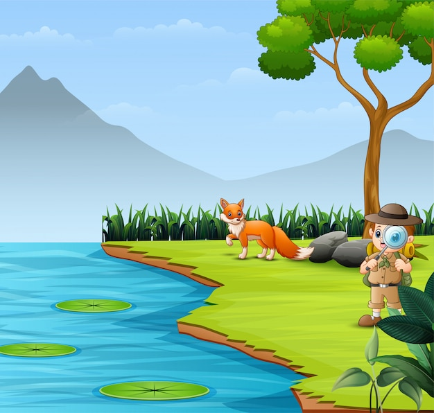 Le garçon explorateur dans la rivière avec un renard
