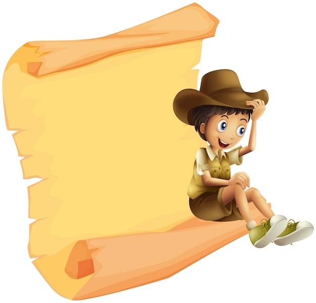 Un garçon et une feuille de papier