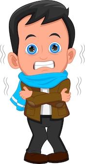 Le garçon a de la fièvre et frissonne de froid