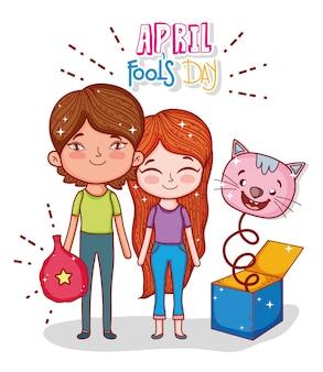 Garçon et fille avec une boîte à chat au jour de l'imbécile