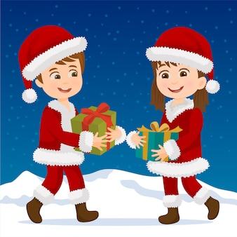 Garçon et fille échangeant un cadeau