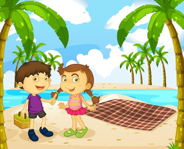 Garçon et fille pique-nique sur la plage