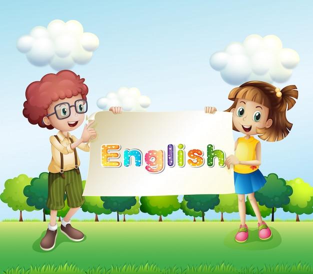 Un garçon et une fille tenant une bannière