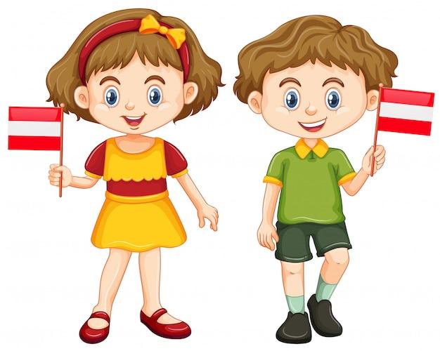 Garçon et fille tenant le drapeau de l'autriche