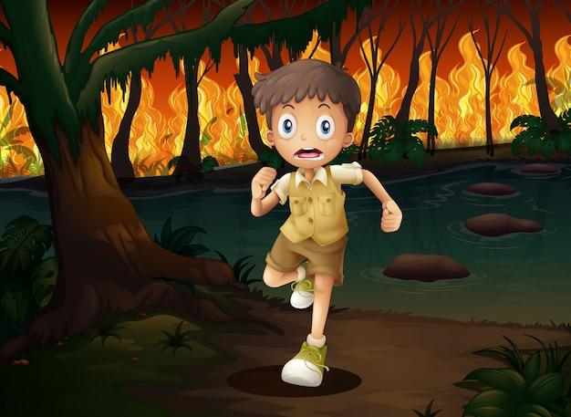 Un garçon fuyant un feu de forêt