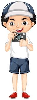 Un garçon heureux avec appareil photo numérique