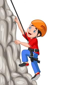 Garçon heureux cartoon escalade le rocher