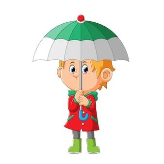 Le garçon avec l'imperméable mignon tient le parapluie de l'illustration