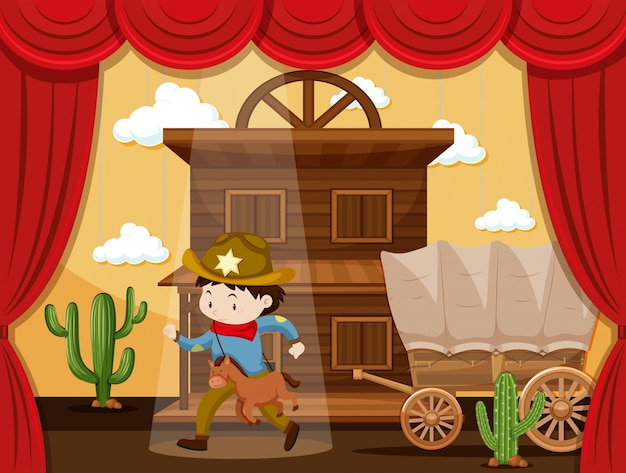 Garçon jouant au cowboy sur scène