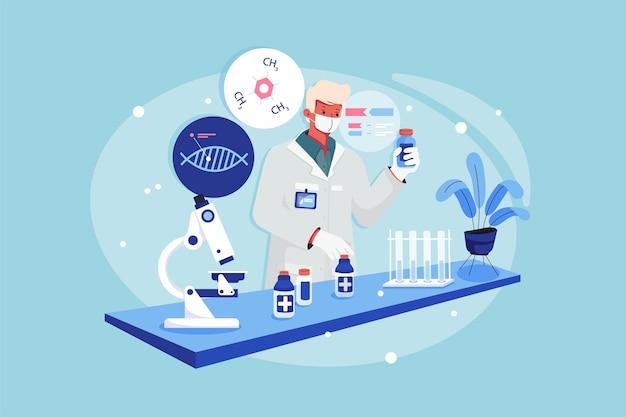 Garçon de laboratoire tenant le flacon de médicament dans une main