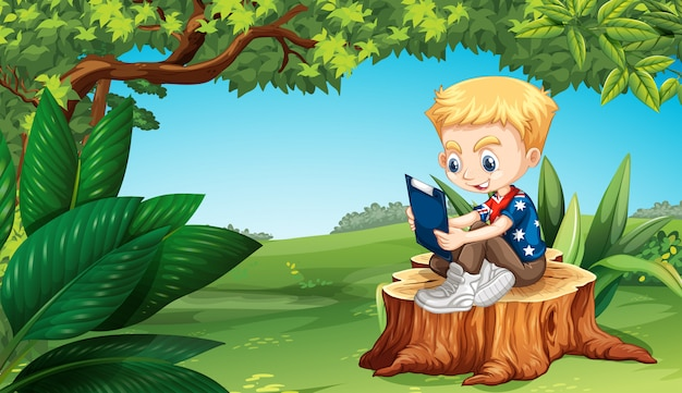 Garçon lisant dans le parc