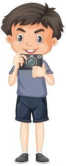 Garçon mignon avec appareil photo sur blanc