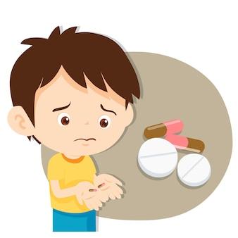 Un garçon mignon ne veut pas prendre de médicaments