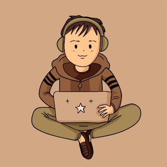 Garçon mignon avec ordinateur