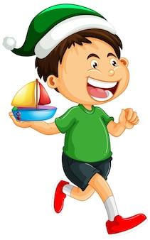 Garçon mignon portant un chapeau de noël et jouant avec son jouet