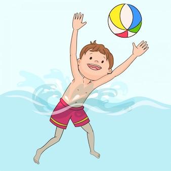 Garçon nageant dans la piscine