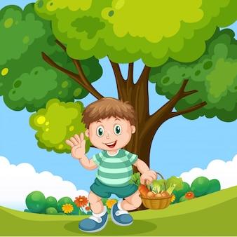 Garçon avec panier de légumes au parc