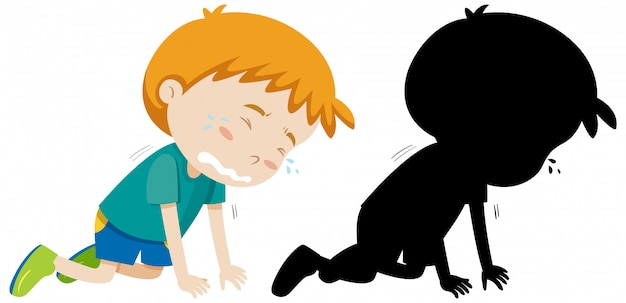 Garçon pleurant sur le sol avec sa silhouette