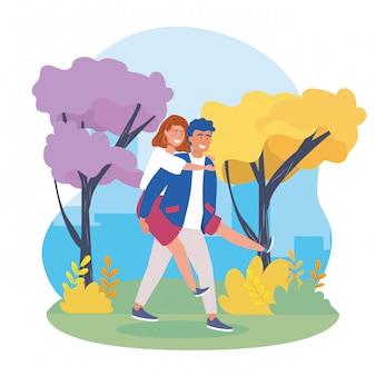 Garçon portant le couple de filles à l'arrière avec des vêtements décontractés
