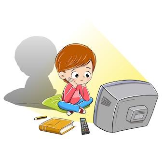 Garçon regardant la télévision distrait et ne lisant pas un livre