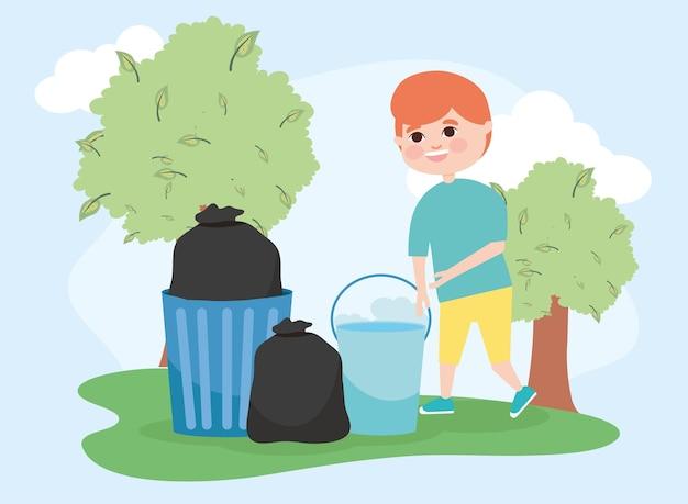 Garçon seau et sacs poubelles au paysage