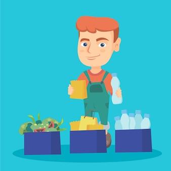 Garçon séparant les déchets de plastique, de papier et de nourriture.