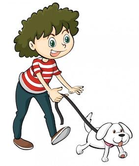 Un garçon souriant et un chien