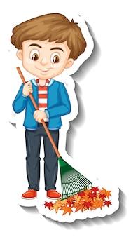 Un garçon tenant un autocollant de personnage de dessin animé de balai