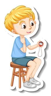 Un garçon tenant un autocollant de personnage de dessin animé de minuterie