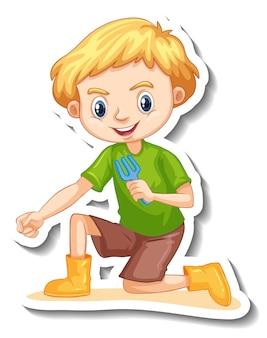 Un garçon tenant un autocollant de personnage de dessin animé d'outil de jardinage