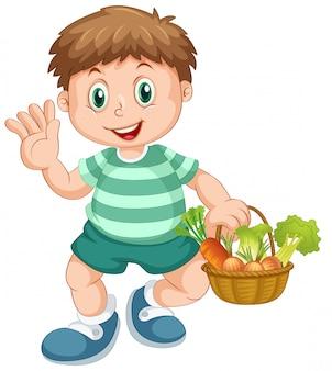 Un garçon tenant un panier de légumes