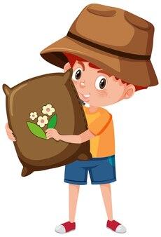 Garçon tenant le personnage de dessin animé d'outil de jardinage isolé sur fond blanc