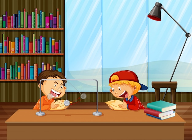 Garçons apprenant en bibliothèque