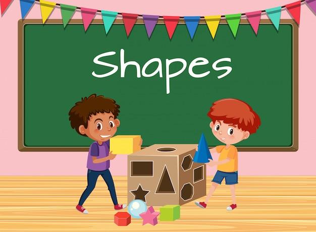 Garçons en classe avec leçon de formes