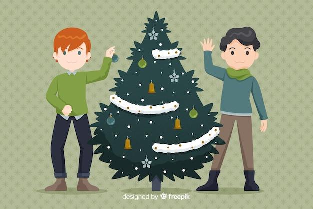 Garçons décorer un arbre de noël