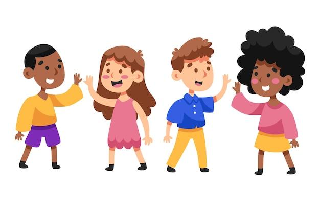 Garçons et filles donnant haut cinq
