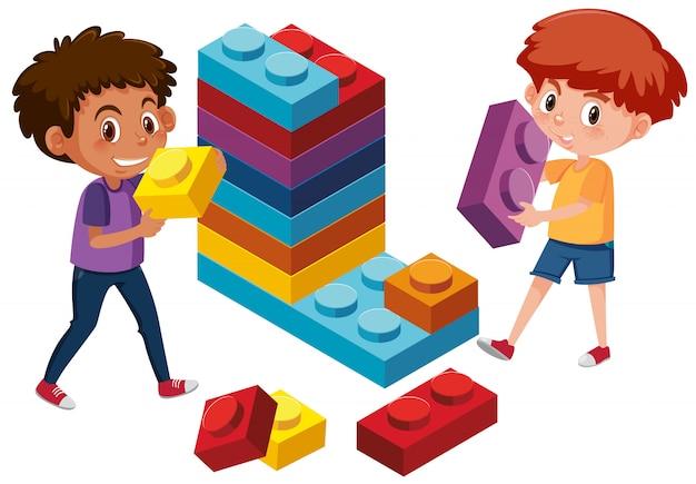 Garçons jouant de la brique lego