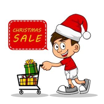 Garçons poussant panier acheter des cadeaux de noël à la vente de noël dans un magasin