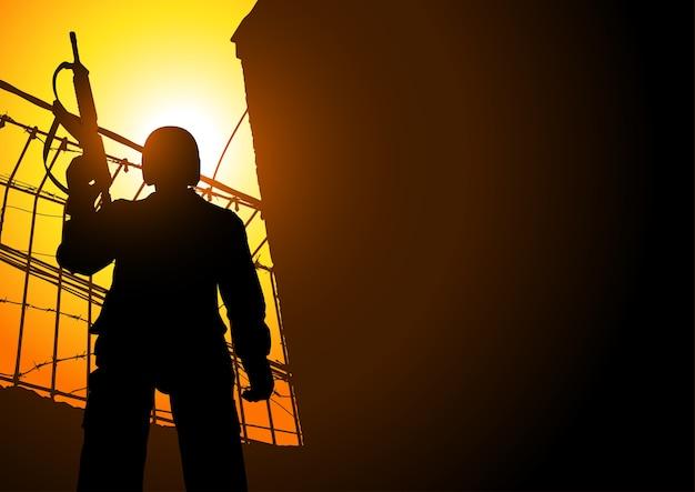 Un garde tenant une mitrailleuse